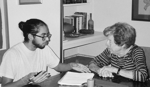 Benji de la Piedra explains an interview legal release with Jean Gordon, former member of the Little Rock School Board and founder of the Arkansas chapter of Women's Action for New Directions. Credit: Sebi Harrigan-Labarca